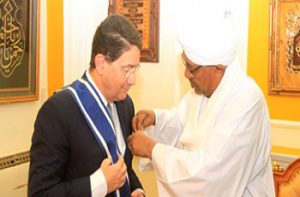 President al-Bashir bestows Order of the Two Niles (First Class) on Mr. al-Rufae'e
