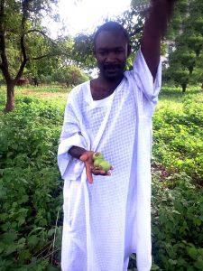 Zakariya under a shea tree